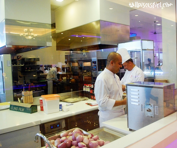 Open kitchen that lets you take a peek on how they handle the food