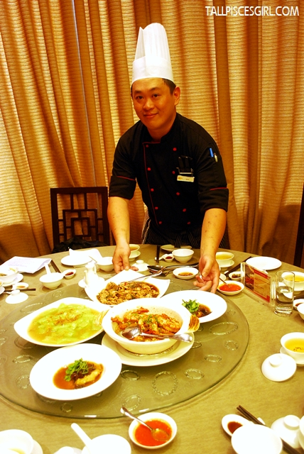 Chef Woon Ting Keat with the array of dishes served