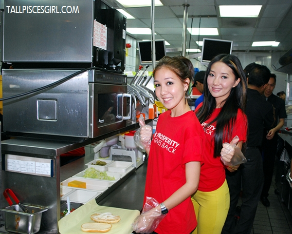 Megan and Chelsia preparing some burgers in the kitchen!