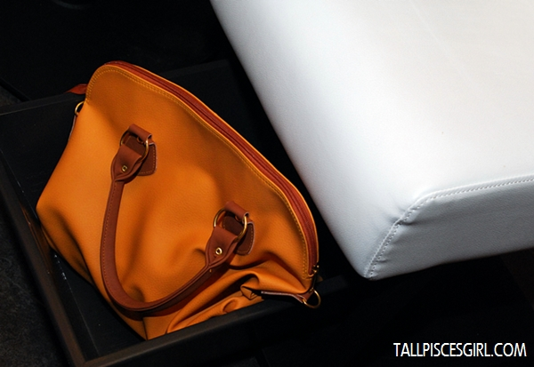I love the fact that they have a tray beneath your seat so you can put your belongings securely!