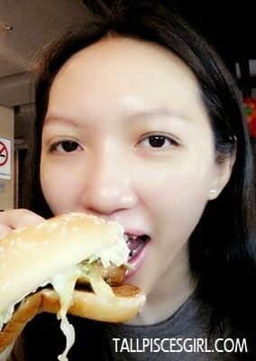 Enjoying my McDonald's GCB. My mouth is not as big as the burger LOL!
